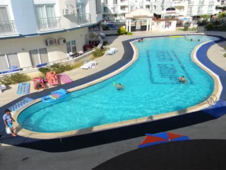 Didim Efeler Mahallesinde Havuzlu Site İçinde Ucuz Fiyata Satılık 2+1 Daire